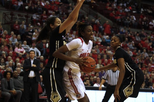 OSU then-sophomore forward Alexa Hart (22) posts up a Purdue defender inside the paint in a game against the Boilermakers on Jan. 17, 2016 at the Schottenstein Center. She had 10 points and 12 rebounds on Sunday agianst Cincinnati.  Credit: Kevin Stankiewicz | Oller Reporter
