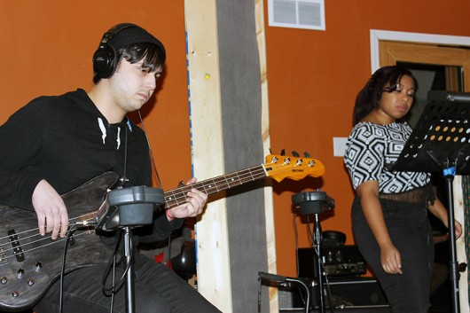 Bassist Raad Shubaily and vocalist Marnée Richardson are deep in concentration during valuable recording time. Credit: Zak Kolesar | Lantern Reporter