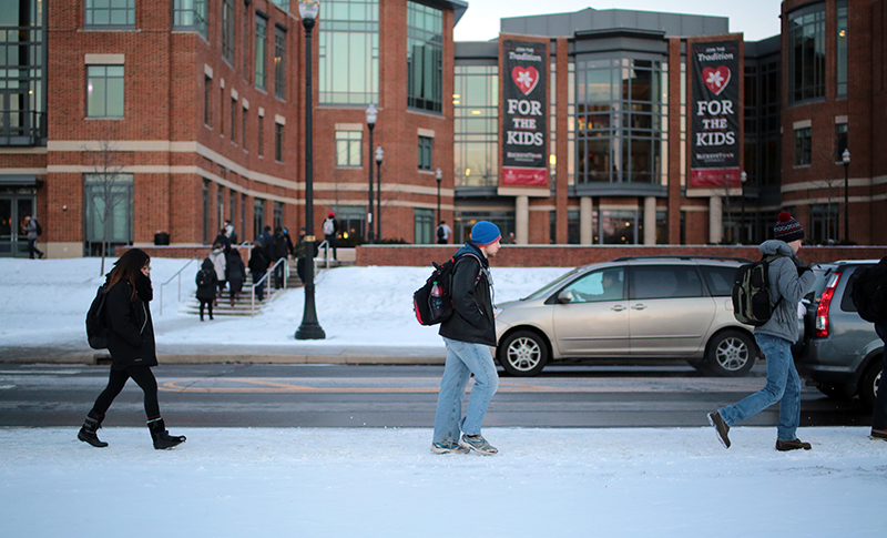Students brave the cold and snow while walking to class on Jan 12. Credit: Muyao Shen | Asst. Photo Editor