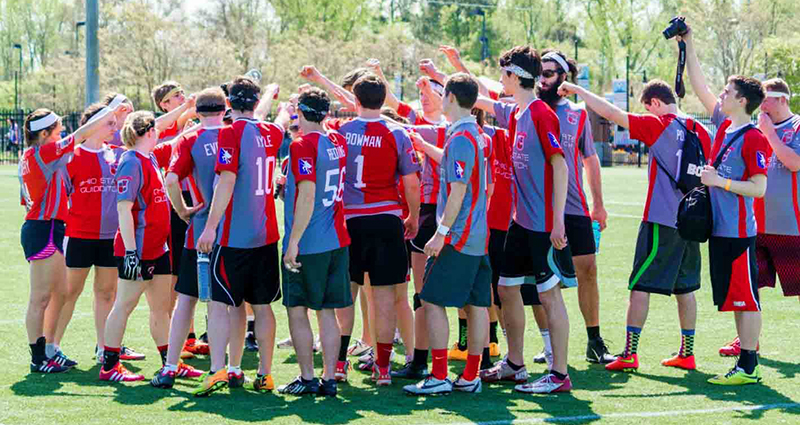 Members of the Ohio State Quidditch League huddle during a match. Credit: Courtesy of Jessica Jiamin Lang Photography