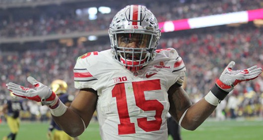 Former OSU running back Ezekiel Elliott poses after scoring a touchdown in the 2016 Fiesta Bowl. Elliott was one of five Buckeyes selected in the first round on Thursday. Credit: Samantha Hollingshead | Photo Editor