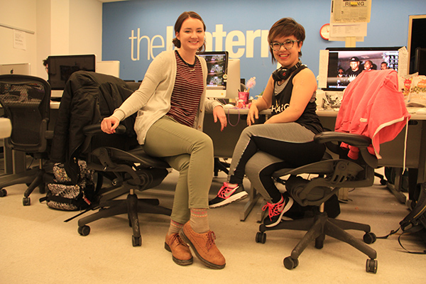 Arts Editors Hannah Herner and Sallee Ann Ruibal pose for a picture in The Lantern Newsroom. Credit: Kevin Stankiewicz | Assistant Sports Editor