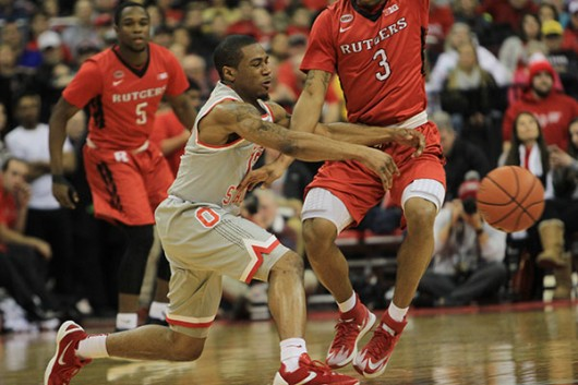 OSU freshman guard A.J. Harris (12) passes the ball to a teammate in a game against Rutgers on Jan. 13 at the Schottenstein Center. OSU won, 94-68. Credit: Samantha Hollingshead | Photo Editor