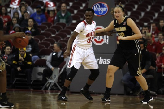 OSU junior forward Shayla Cooper (32) and Purdue sophomore center Bree Horrocks jostle for position in a game on Jan. 17 at the Schottenstein Center. OSU won, 90-70. Credit: Kevin Stankiewicz | Asst. Sports Editor