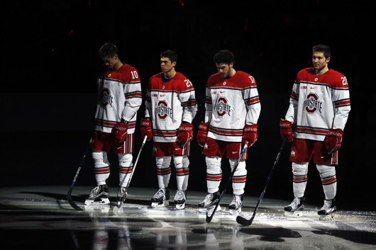 OSU hockey players stand in the spotlight during introductions for a game against Michigan on Jan. 15 at the Schottenstein Center. Credit: Kevin Stankiewicz   Asst. Sports Editor