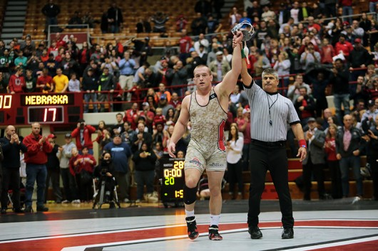 OSU sophomore Kyle Snyder gets his hand raised during a meet against Nebraska at St. John Arena on Jan. 17. OSU won 21-17. Credit: Muyao Shen | Asst. Photo Editor