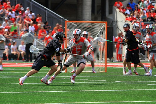 OSU then-freshman Erik Evans (43) defends a Maryland player in a game on April 18 at Ohio Stadium. Credit: Lantern File Photo