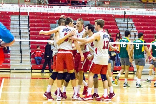 Members of the OSU men's volleyball team celebrate during a game against George Mason at St John Arena on Jan. 15. Credit: Ed Momot | For The Lantern