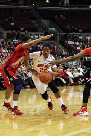 OSU sophomore guard Asia Doss (20) dribbles during a game against Rutgers on Jan. 10 at the Schottenstein Center. Credit: Samantha Hollingshead | Photo Editor