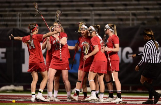 OSU women's lacrosse members celebrate a win over Maryland on May 1. Credit: Courtesy of Ben Soloman