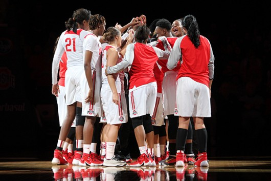 OSU women's basketball players huddle before a game against Rutgers on Jan. 10 at the Schottenstein Center. Credit: Lantern File Photo