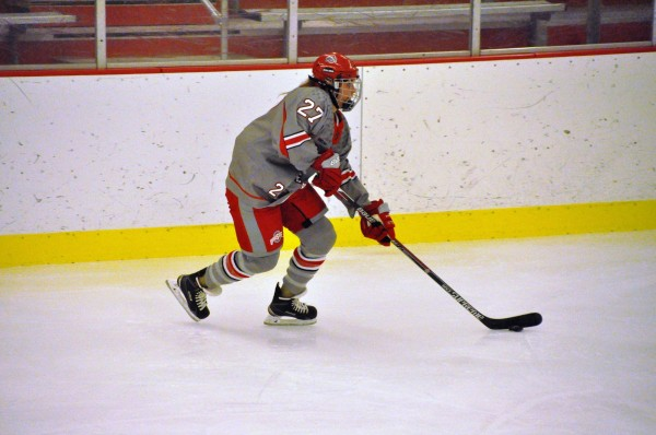 OSU sophomore forward Lauren Spring (27) controls the puck during a game against Minnesota on Oct. 16 at the OSU Ice Rink. OSU lost 7-2. Credit: Courtesy of OSU