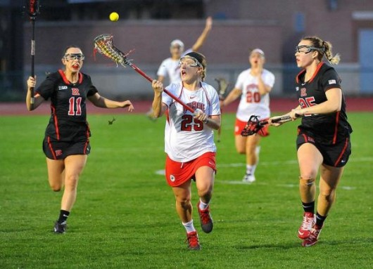 Then-junior midfielder Christine Easton (25) catches the ball during a game against Rutgers on April 16. OSU won 17-7. Credit: Courtesy of OSU