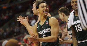 Michigan State senior guard Bryn Forbes (5) cheers from the bench during the Spartans'