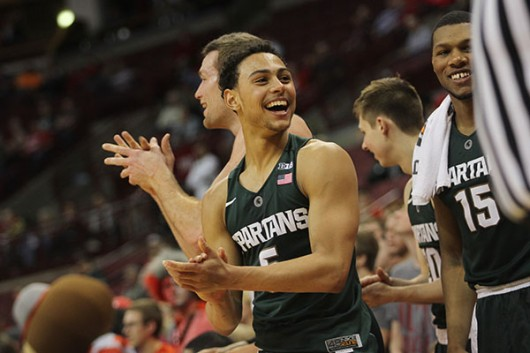 Michigan State senior guard Bryn Forbes (5) cheers from the bench during the Spartans' 81-62 win over Ohio State at the Schottenstein Center on Feb. 23. Credit: Samantha Hollingshead | Photo Editor