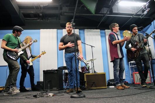 "From left, Pat Chase, Adam Woelfel, Matt Chalko, Chris Cheeseman and Tim Swanson jam out while playing ""Euthanasia"" in the Lantern TV Studio. Credit: Zak Kolesar | Lantern Reporter"