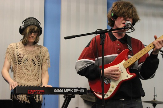 Keyboardist Brooklyn Ludlow and guitarist and vocalist Nick Wellman heavily concentrate on playing their instruments during a performance at the Lantern TV Studio. Credit: Zak Kolesar | Lantern Reporter
