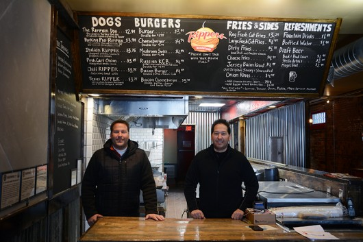 Carmen Gio (left) and Nick Gio (right) pose for a photograph behind the counter of Rippers Roadstand. Credit: Kevin Stankiewicz | Assistant Sports Editor