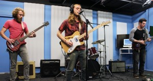 From left, bassist and vocalist Chase Finley, vocalist and guitarist David Lurie and guitarist Michael Bohm concentrate while playing  at the Lantern TV Studio. Credit: Zak Kolesar | Lantern Reporter