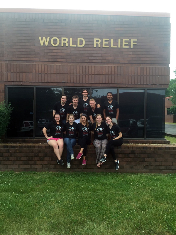 Members from the student organization Students for Refugees pose in front of the World Relief building, who they partner with to provide tutoring services to local refugees. Courtesy of Chelsea Bray