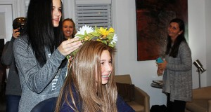 Lauren Palmar presents Gabrielle Lauren Palmar presents Gabrielle Poulakis (12) with her flower crown of gerber daisies after her wig is revealed at Atelier Salon on February 5, 2016. Credit: Hannah Roth | Lantern Reporter