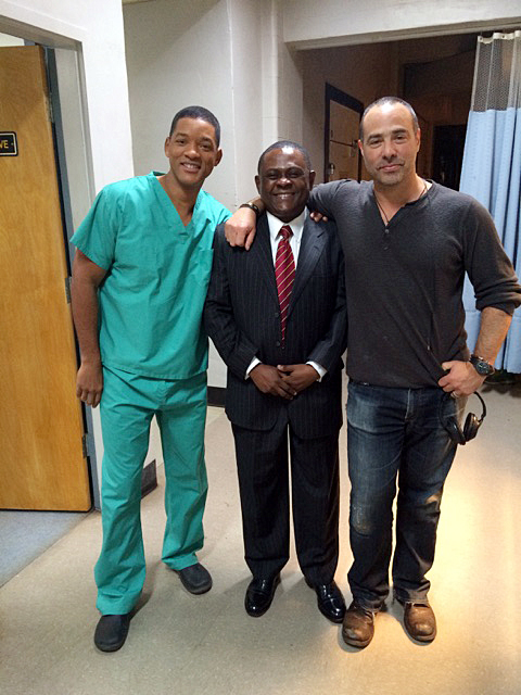 "From left to Right: Will Smith, Dr. Bennet Omalu, and Peter Landesman, the writer and director of the film ""Concussion, on set during filming. Credit: Courtesy of Michael D'Andrea"