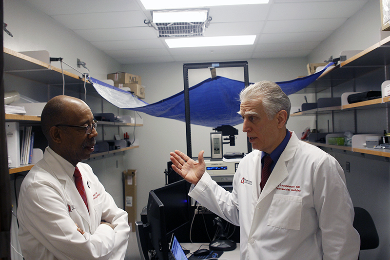 OSU President Michael Drake and Dr. Ray Hershberger chat during a tour of the Wexner Medical Center on Feb. 24. Credit: Jay Panandiker | Engagement Editor