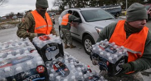 US Army National Guard 125th Infantry Battalion members from Michigan hand out water at Flint Fire Department Station 1 to help residents dealing with lead in their drinking water during the Flint water crisis. Credit: Courtesy of TNS