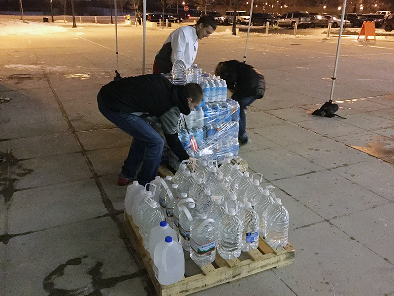 A crew works to secure donations for placement in the truck at the end of night one of the Flint water drive. Credit: Elizabeth Suarez | Lantern Reporter