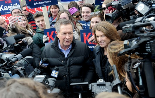 Governor of Ohio and 2016 Republican presidential candidate John Kasich greets voters while arriving at a polling station in Concord, New Hampshire on Feb. 9. Credit: Courtesy of TNS
