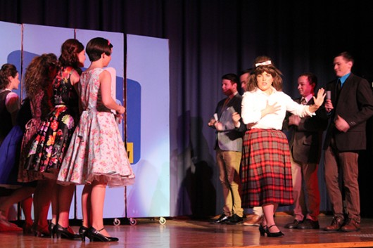 """Rachel Dummermuth, who is portraying Tracy Turnblad, rehearses with the rest of the cast of Off the Lake production's """"Hairspray."""""""