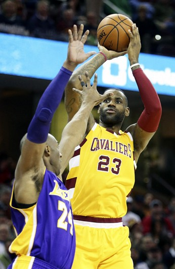 The Cleveland Cavaliers' LeBron James (23) puts up a shot during a game against the Los Angeles Lakers' Kobe Bryant in Cleveland on Feb. 10. Credit: Courtesy of TNS