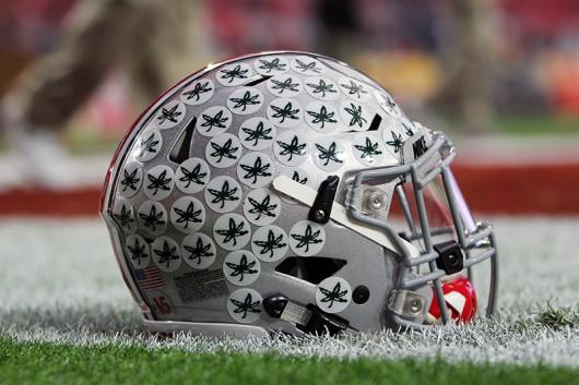 An OSU helmet sits on the field before the 45th annual BattleFrog Fiesta Bowl on Jan. 1 at University of Phoenix Stadium in Glendale, Arizona. OSU won 44-28. Photo Credit: Samantha Hollingshead | Photo Editor