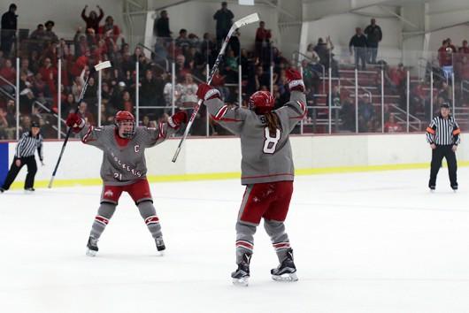 OSU junior defenseman Alexa Ranahan (21) and sophomore defenseman Dani Sadek (8) celebrate after a goal during a game against North Dakota on Feb. 20. Credit: Michael Buchsieb | For The Lantern