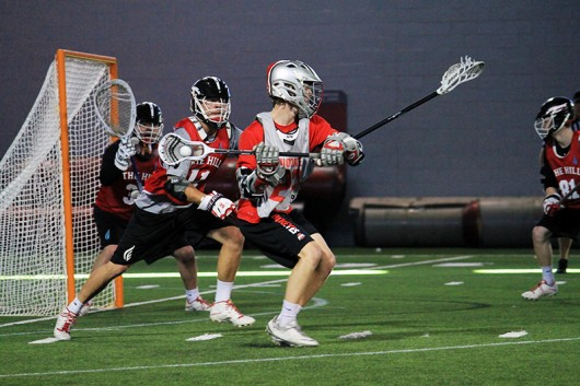 OSU sophomore attacker Colin Chell (22) prepares to shoot during a scrimmage against The Hill Academy on Jan. 30. Credit: Kylie Bryant | | For The Lantern