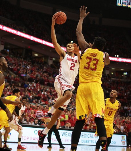 OSU junior forward Marc Loving (2) goes up for a shot during a game against Maryland on Jan. 31 at the Schottenstein Center. OSU lost, 61-66. Credit: Muyao Shen   Asst. Photo Editor