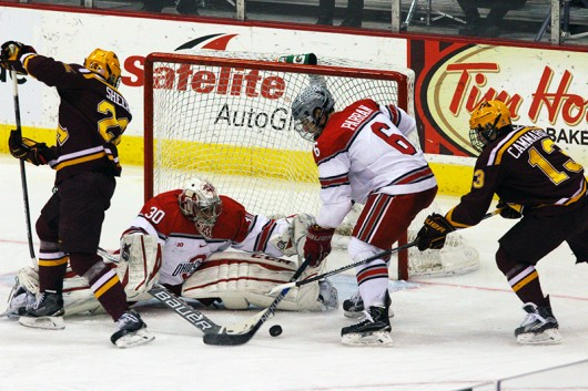 OSU then-freshman defenseman Tommy Parran (6) tries to clear the puck in front of the Buckeyes' goal in a game against Minnesota on Feb. 12, 2016, at the Schottenstein Center. Credit: Lantern File Photo