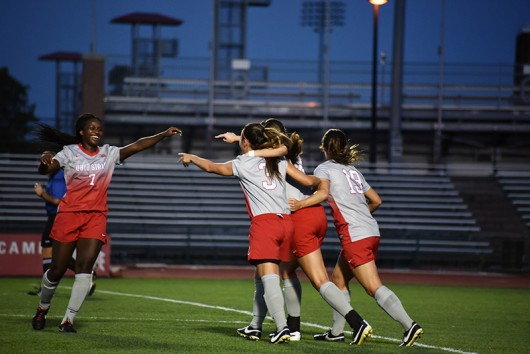 Then-junior forward Nichelle Prince (7) celebrates with teammates after a goal during a game against Minnesota on Sept. 17. Credit: Sam Harris | For The Lantern