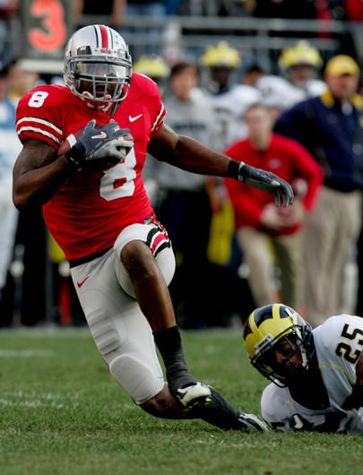 Former OSU wide receiver Roy Hall (8) runs with the ball during a game against Michigan on Nov. 18, 2006. Credit: Courtesy of TNS