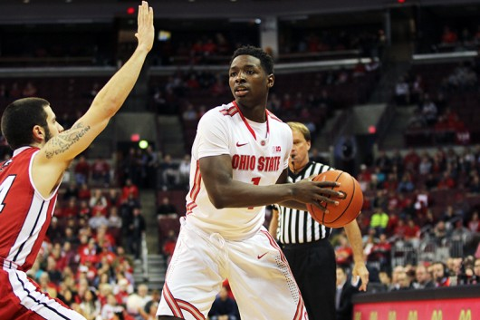 The sophomore forward Jae'Sean Tate (1) looks to make a pass during a game against Northern Illinois on Dec. 16 at the Schottenstein Center. OSU won 64-57. Credit: Lantern file photo