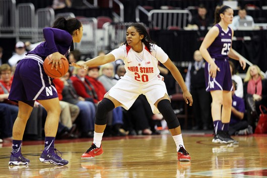 OSU then-sophomore guard Asia Doss (20) defends during a game against Northwestern on Jan. 28 at the Schottenstein Center. Credit: Lantern file photo