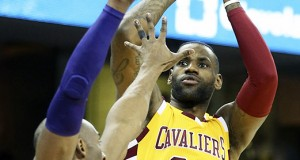 The Cleveland Cavaliers' LeBron James (23) puts up a shot in the first quarter against the Los Angeles Lakers' Kobe Bryant at Quicken Loans Arena in Cleveland on Wednesday, Feb. 10, 2016. The Cavs won, 120-111. Credit: Courtesy of TNS