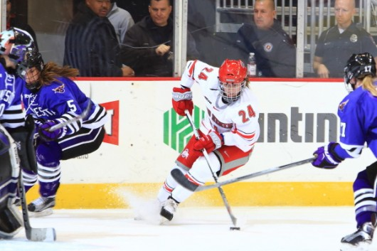 Junior forward Claudia Kepler (24) looks to pass the puck during a game against Minnesota State on Oct. 23 at the Schottenstein Center. OSU won 5-3. Credit: Courtesy of OSU