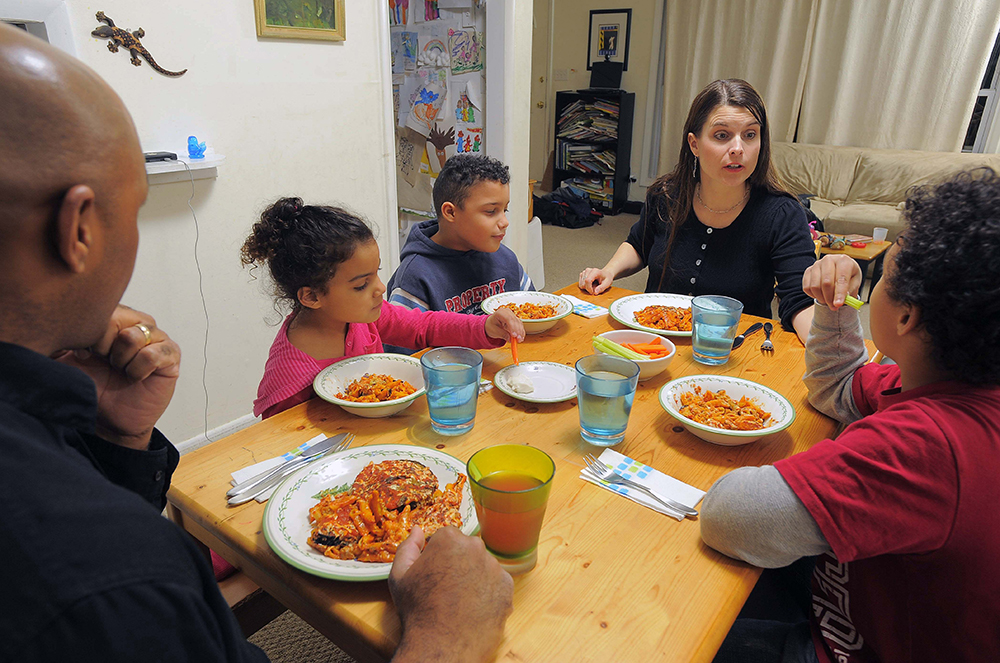 A family sitting down at the dinner table for a meal. Courtesy of TNS