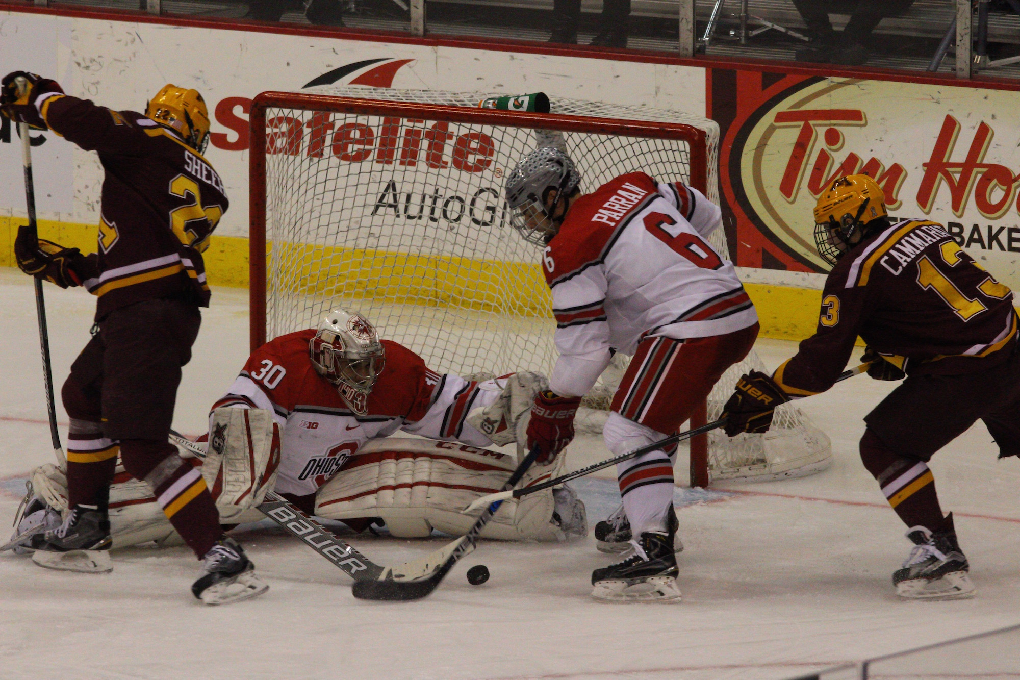OSU forward Tommy Parran (6) tries to clear the puck in front of the Buckeyes' goal in a game against Minnesota on Feb. 12 at the Schottenstein Center. OSU lost, 5-4. Credit: Evan Szymkowicz | Sports Director