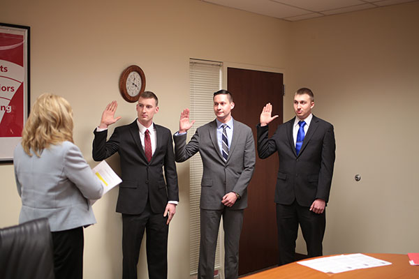 University Police officers Bruce Allen (left), Kyle Yeager (middle) and Chris Dzubak (right) swearing into office on Feb. 9, 2016. Credit: Muyao Shen   Assistant Photo Editor