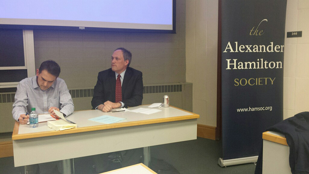 """Alexander Thompson (left), associate professor of political science, and Michael Rubin (right), of the American Enterprise Institute, speak during """"Playing with Fire: The Perils and Pluses of Engaging with Rogue Regimes"""" on Feb. 2."""