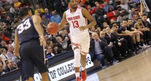 OSU guard JaQuan Lyle (13) leads the offense in the Big Ten tournament against Penn State on March 10 in Indianapolis. Credit: Lantern File Photo