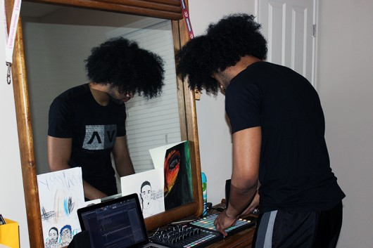 Columbus producer Toese Satele Brewer creates a beat in his makeshift studio, which also serves as his room. Credit: Zak Kolesar | Lantern reporter
