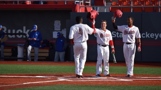 OSU junior left fielder Ronnie Dawson (4) is greeted at home plate after a three-run homer during a 12-1 win over Hofstra on March 18 at Bill Davis Stadium. Credit: Giustino Bovenzi | Lantern reporter